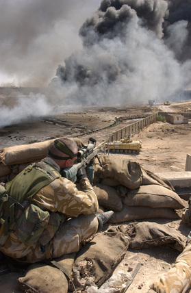 A sniper attached to 1st Battalion Irish Guards near Bridge Four on the outskirts of Basra, Iraq, March 2003.