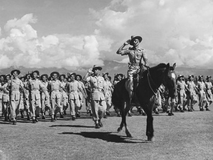A Gurkha detachment taking part in a march past, October 1945