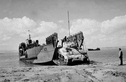 Loading Shermans on a Landing Craft Tank (LCT), 1943.