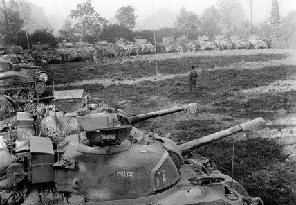 Sherman tanks refuelling, Normandy, 1944
