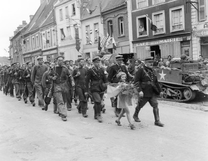French Maquis march to lay a wreath on memorial, 1944