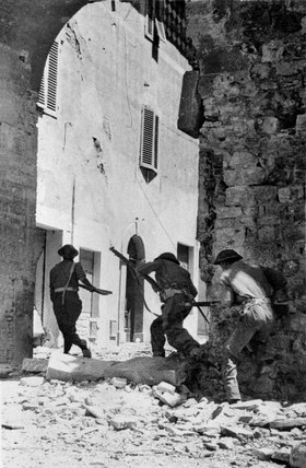 British Infantry moving through the streets of Castiglione, Italy, 1943