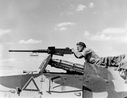 Soldier firing a .50 calibre machine-gun, 1942 (c)