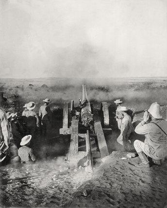 A naval gun firing, Modder River, 1899