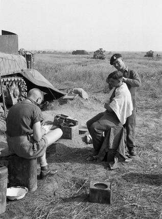 British tank crew receiving haircuts, 1944