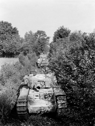 A Churchill AVRE moving through close country, Normandy, 1944