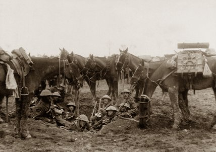 Cavalrymen resting in a shell hole, 1916 (c)