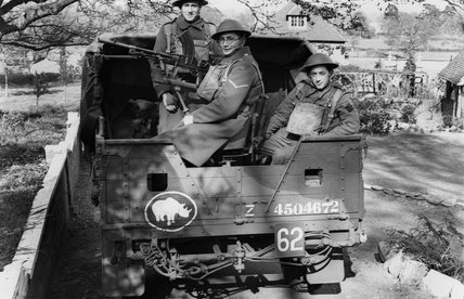 Soldiers in the back of a truck, 1940 (c)