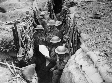 Reading a newspaper in the trenches, 1916 (c)
