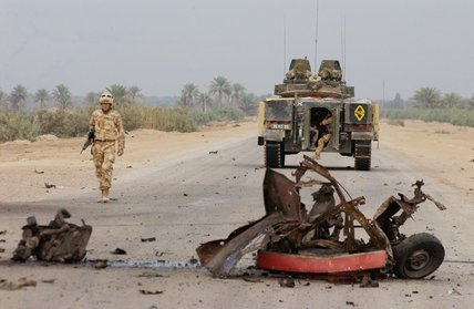 Black Watch commander walks to the scene of a vehicle bomb, Iraq, October 2004