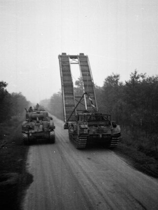 A Churchill AVRE bridge-layer passing a Sherman tank, 1944
