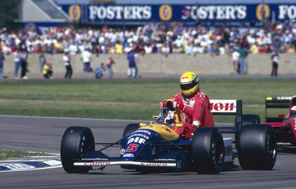 Nigel Mansell giving Ayrton Senna a lift back