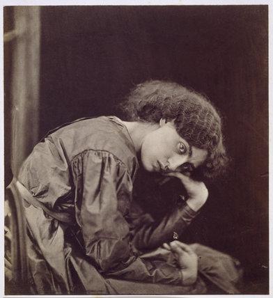 Jane Morris, seated on divan, Three-quarter length