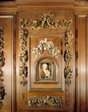 Decorative carved picture surround framing a Madonna and Child in the style of Joos Van Cleve