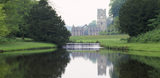 Fountains Abbey, C12th Cistercian abbey, taken from Half Moon Pond, showing the Chapel of the Nine Altars and the Tower, their reflection in the water and the weir