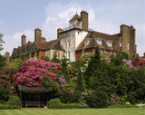 Massed rhododendrons cover the slope between the Croquet Lawn summer-house and the south-east corner of the Standen
