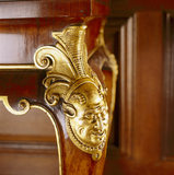 Detail of carved cabriole legs of C18th walnut tables in the Tapestry Room at Antony