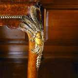 Detail of carved cabriole legs of C18th walnut tables in the Tapestry Room