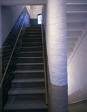 """Interlocking """"Double"""" Staircase viewed from first floor landing showing stairs up and stairs down and central wall"""