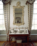 View of the mirror and wash-stand in the Rose Bedroom at Felbrigg Hall