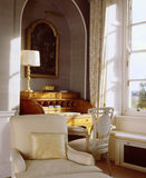 Interior view towards Sheraton style satinwood cylinder bureau and chair in the south bedroom at Hinton Ampner