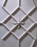 Detail of the plasterwork ceiling in the Hall at Trerice showing an ornamental section decorated with the initials K.A.