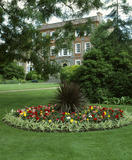 An island bed planted in typical Victorian style with brightly coloured begonias on the Palm Lawn at Peckover House