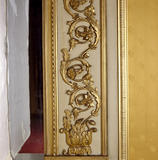 Wimpole Hall, Yellow Drawing Room, detail of Vitruvian scroll and foliage decoration in border to chimney piece mirror