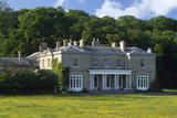 Sheringham Hall at Sheringham Park, the large woodland garden was designed in 1812 by Humphry Repton and is famous for its spectacular show of rhododendrons and azaleas