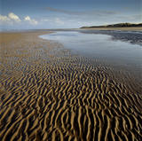 The deserted beach at Formby, Merseyside, with wave-patterned sand