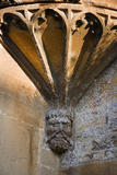 Mask corbel at the base of the tracery of the East oriel window at the fifteenth-century Great Chalfield Manor, Wiltshire