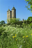 The Wild Garden at Sissinghurst Castle, in June, with the twin towers, in the background, reaching up to the sky