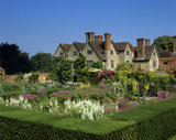A view over the Sunken Garden towards the sixteenth-century Packwood House, Warwickshire