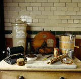 A selection of kitchen implements including a knife polisher and an earthenware steriliser in the Kitchen at Wightwick Manor