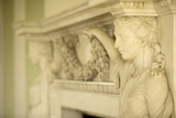 The Adams fireplace in the Long Gallery at Croome Court, Croome Park, Worcestershire, with life-size marble Nymphs of Flora