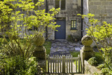 Wooden gate leading to the east side of the house at Godolphin House, once the home of Queen Anne's Lord High Treasurer, Sidney Godolphin, near Helston, Cornwall