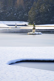 The Half-Moon Pond and statue under snow at Studley Royal Water Garden, North Yorkshire