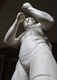 Close view of The British Pugilist sculpture (1828), also called Athleta Britannicus, by John Charles Felix Rossi (1762-1839)  in the North Gallery at Petworth House, West Sussex