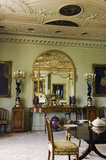 The Dining Room at Hinton Ampner, Hampshire, showing the giltwood pier glass designed by Robert Adam in 1773