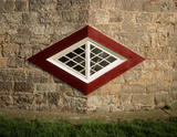 Detail of diamond shaped window on one of the corners