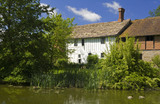The side of Lower Brockhampton House, the medieval manor house, from across the moat on the Brockhampton Estate in Worcestershire