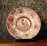 William De Morgan lustreware plate depicting a pelican in a nest with chicks, red on white, in the Drawing Room at Wightwick Manor