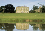 View of the West Front of Claydon House with the meadow and lake in the foreground