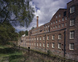 Quarry Bank Mill from the Mill Meadow with the river alongside