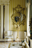 An oval gilt pier glass, late George II, in the Drawing Room at Hinton Ampner, Hampshire
