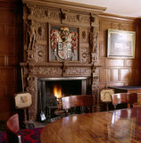 View of the Private Dining Room at Calke Abbey, showing the Elizabethan chimneypiece with the Harpur arms and the fireplace