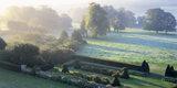 Misty view across the park and sunken garden at Hinton Ampner in October
