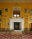 View of the fireplace in The Drawing Room at Charlecote Park