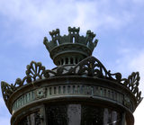 A close view of an elaborate and decorative outdoor lamp with metalwork detailing at Mottisfont Abbey