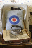 Newspapers, an iron and a cushion with a target design in the 1970s tailor's shop at the Birmingham Back to Backs